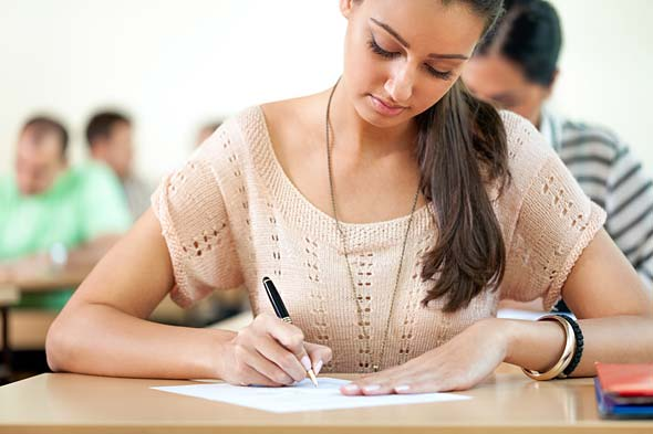 Student sitting an exam - your course is guaranteed to run